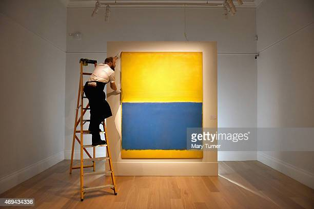 A gallery technician makes adjustments to the hanging of Mark Rothko's 'Untitled executed in 1954 as the work goes on show at Sotheby's on April 10...