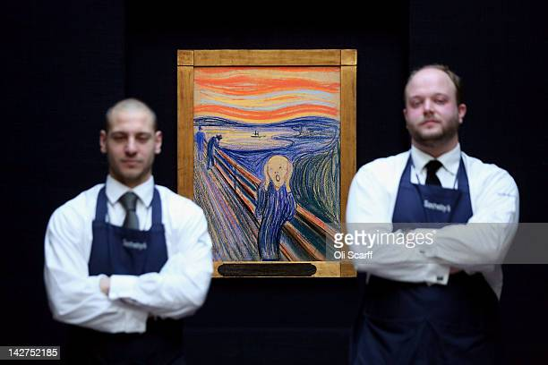 Gallery technicians at Sotheby's auction house stand guard in front of 'The Scream' by Edvard Munch on April 12 2012 in London England The iconic...