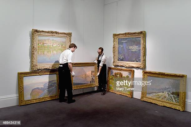 Gallery technicians carry Claude Monet's 'Le Palais Ducal' from a collection of six pieces of the artist's work which are going on show at Sotheby's...
