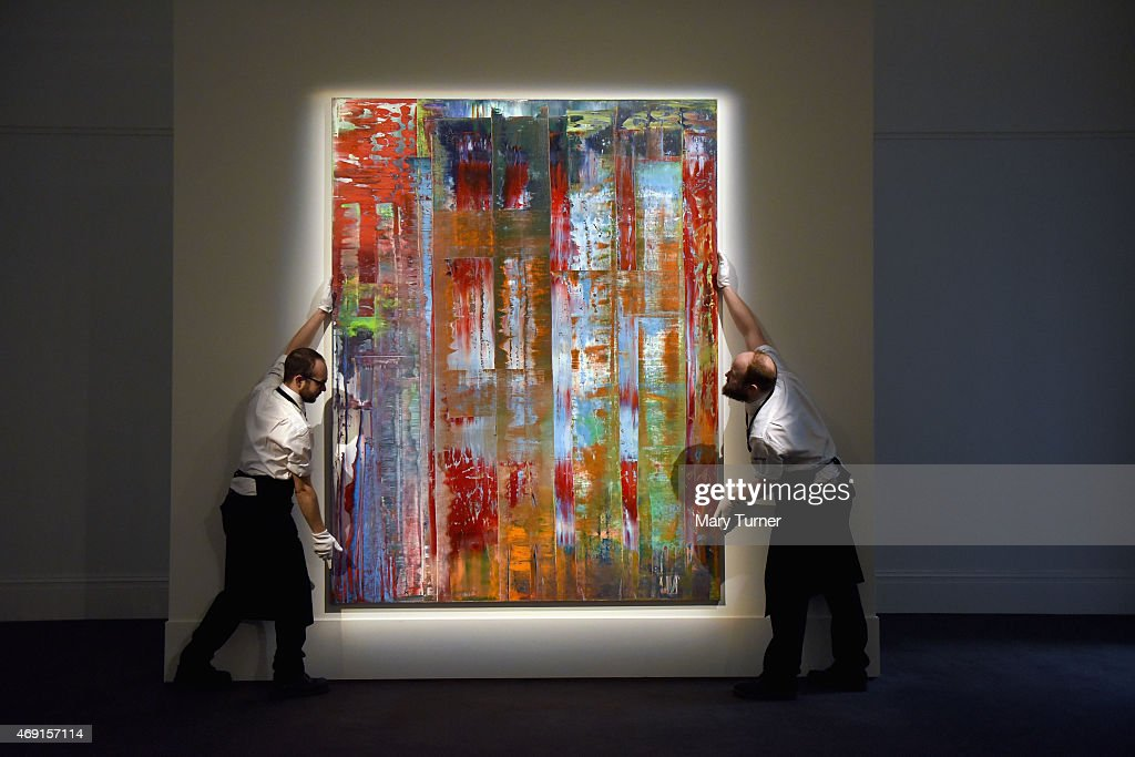 Gallery technicians lift <a gi-track='captionPersonalityLinkClicked' href=/galleries/search?phrase=Gerhard+Richter&family=editorial&specificpeople=661262 ng-click='$event.stopPropagation()'>Gerhard Richter</a>'s 'Abstraktes Bild', 1992 (estimated in the region of $30m), into place as the work goes on show at Sotheby's on April 10, 2015 in London, England. The exhibition of masterpieces including works by Monet, Van Gogh, Rothko, Richter and Polke takes place from April 10 -14th before the works are auctioned in New York in May.