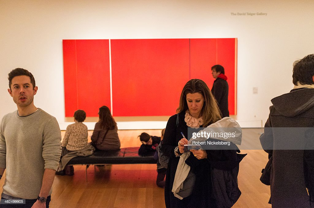 Gallery visitors pass through a modern art exhibit at the Museum of Modern Art December 12, 2014 in the Manhattan borough of New York City.