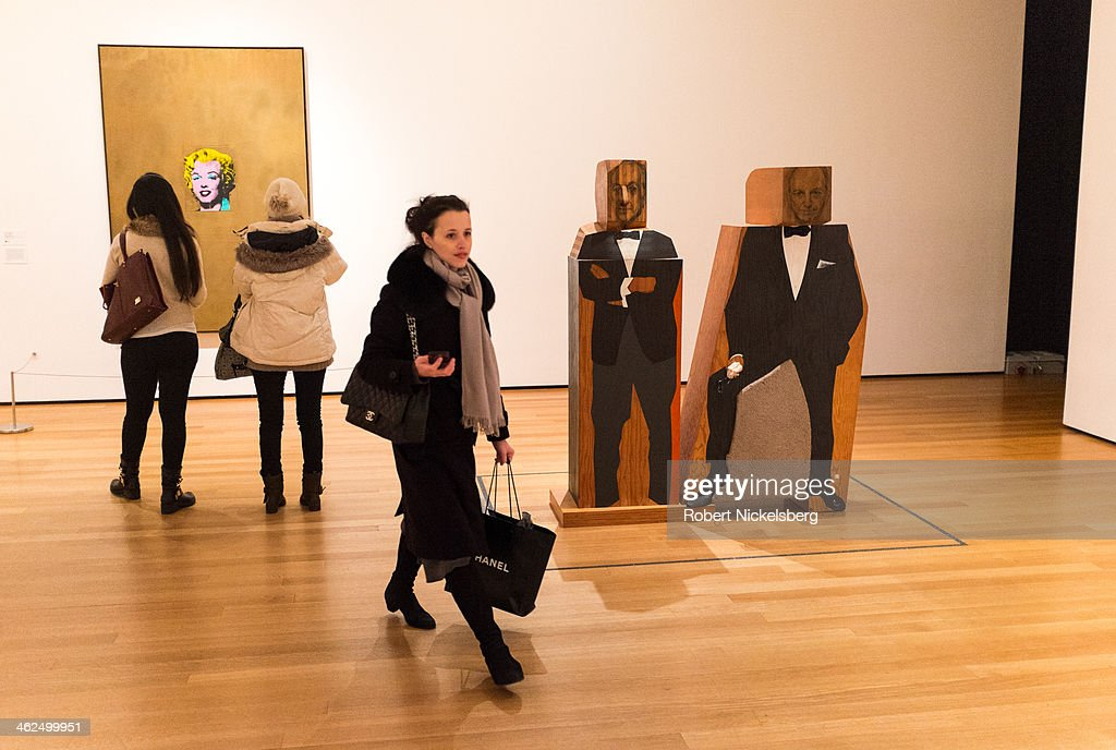 Gallery visitors pass through the pop art exhibit at the Museum of Modern Art December 12, 2014 in the Manhattan borough of New York City.