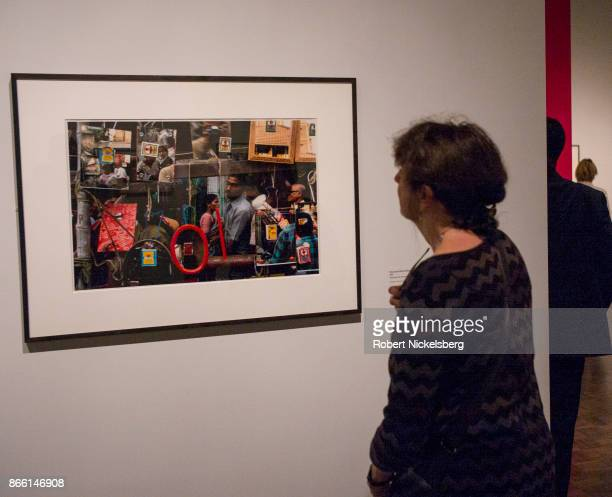 Gallery visitors view work by Indian photographer Raghubir Singh at the Met Breuer Museum in New York City October 14 2017 Singh was a pioneer of...