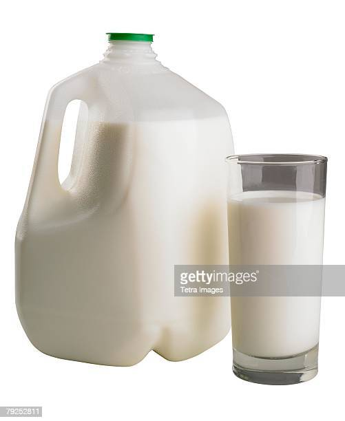 A gallon and glass of milk