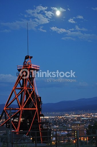 gallow frame in red neon full moon in butte montana stock photo