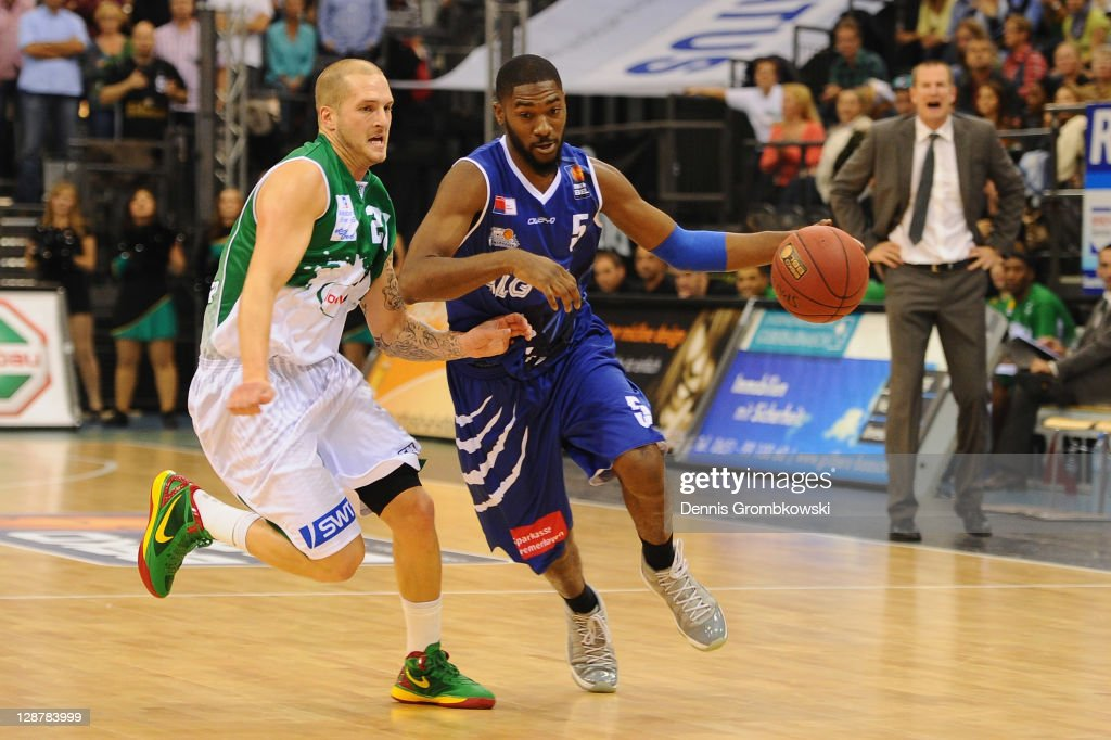 J Gallup of Trier and Terell Everett of Bremerhaven battle for the ball during the BEKO BBL Bundesliga match between TBB Trier and Eisbaeren...