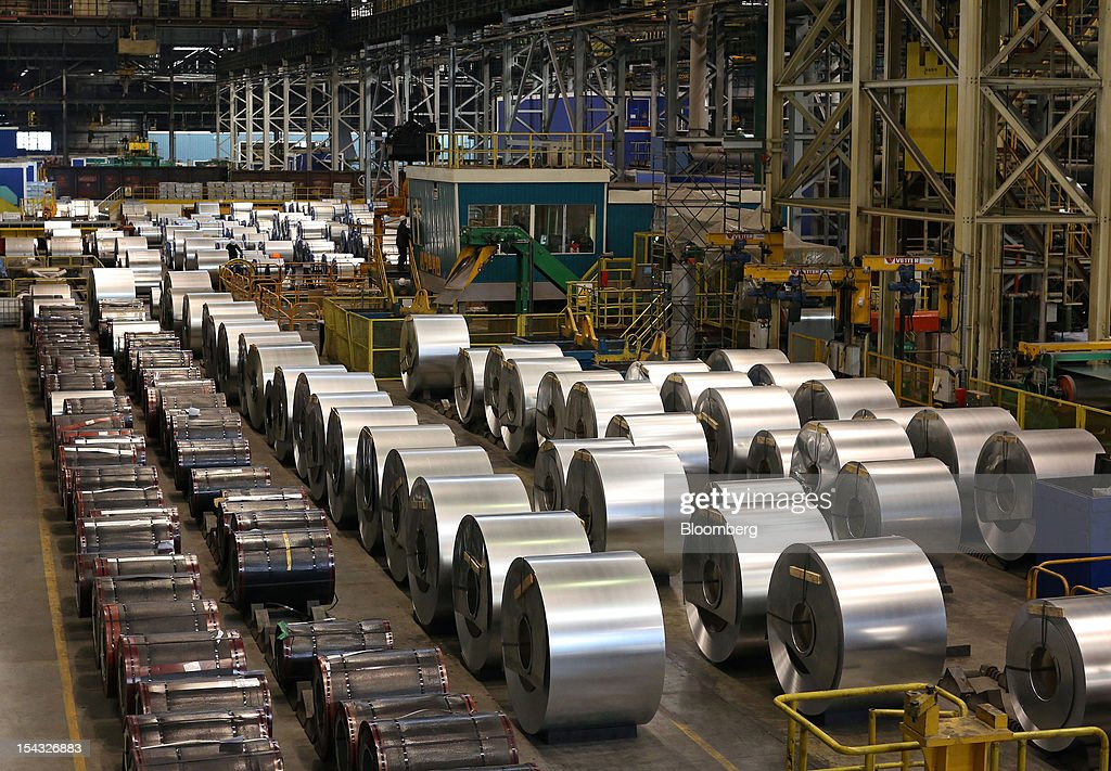 Galvanised steel rolls, right, stand after manufacture at the OAO Novolipetsk Steel plant, also known as NLMK, in Lipetsk, Russia, on Wednesday, Oct. 17, 2012. OAO Novolipetsk Steel, controlled by billionaire Vladimir Lisin, became Russia's largest steelmaker by output after boosting production by 24 percent. Photographer: Andrey Rudakov/Bloomberg via Getty Images