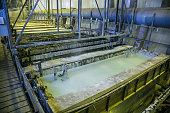 Galvanizing in etching acid containers in galvanic workshop.
