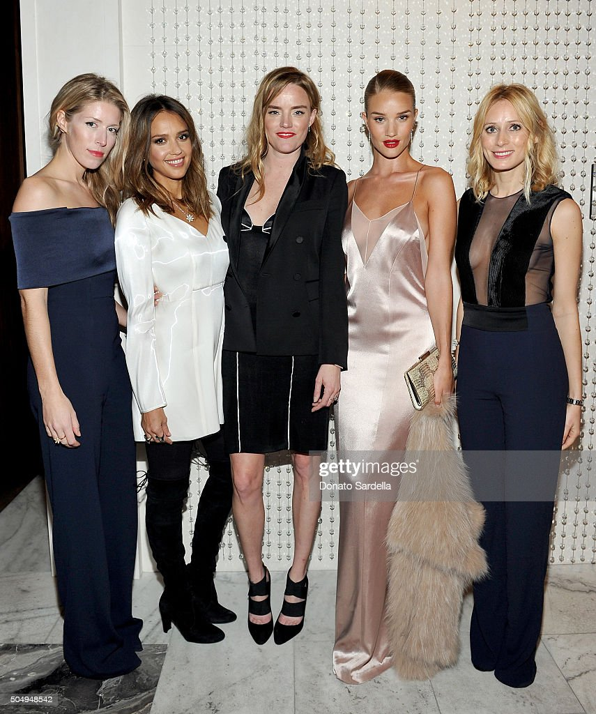 Galvan's Anna-Christin Haas, actress Jessica Alba, Galvan's Sola Harrison, model/actress Rosie Huntington-Whiteley, and Galvan's Katherine Holmgren attend the Galvan For Opening Ceremony Dinner Hosted By Swarovski at Private Residence on January 13, 2016 in Los Angeles, California.
