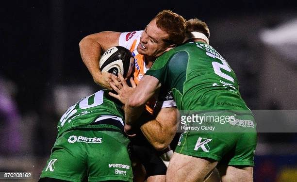 Galway Ireland 4 November 2017 Ernst Stapelberg of Cheetahs is tackled by Naulia Dawai left and Tom McCartney of Connacht during the Guinness PRO14...