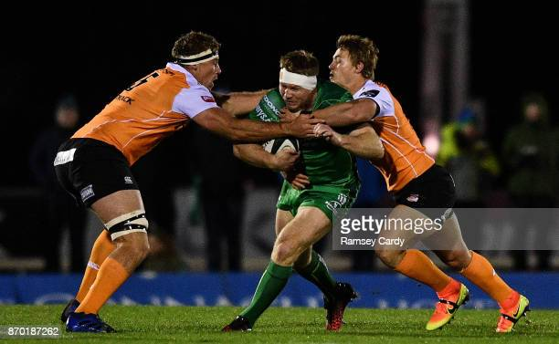 Galway Ireland 4 November 2017 Tom McCartney of Connacht is tackled by Hugo Reniel left and Tertius Kruger of Cheetahs during the Guinness PRO14...