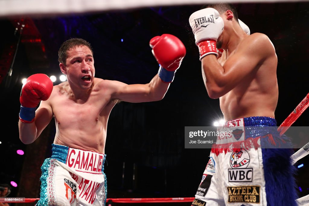 Gamaliel Diaz punches Christian Gonzalez in the third round of their Super Lightweight at Belasco Theatre on October 6, 2017 in Los Angeles, California.