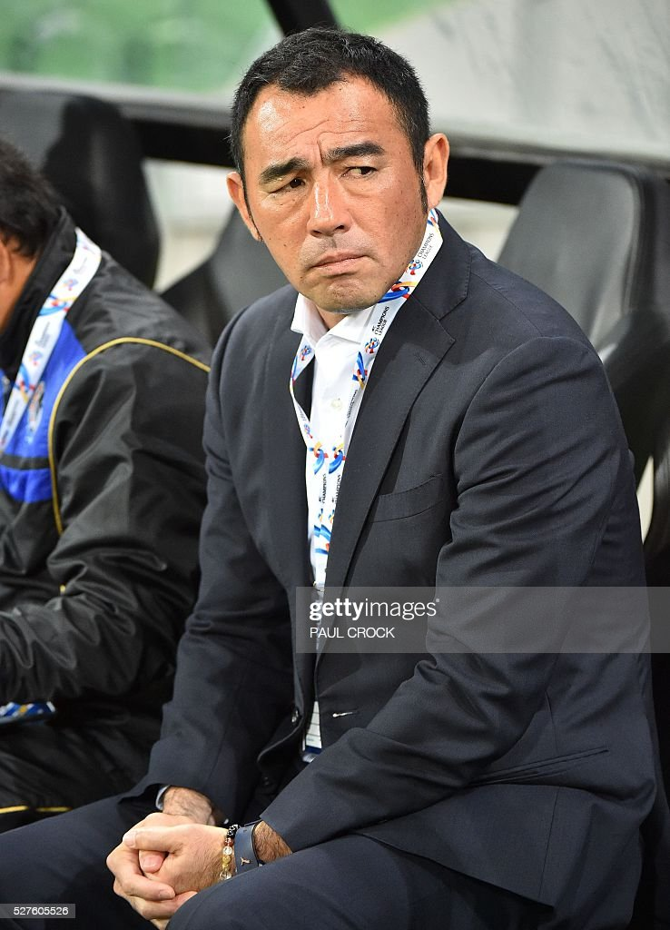 Gamba Osaka coach Kenta Hasegawa waits for the start of play for the AFC Champions League football match between the Melbourne Victory and Gamba Osaka in Melbourne on May 3, 2016. / AFP / Paul Crock / IMAGE
