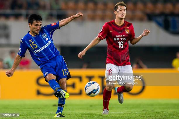 Gamba Osaka defender Konno Yasuyuki fights for the ball with Guangzhou Evergrande midfielder Huang Bowen during the AFC Champions League 2015 Semi...