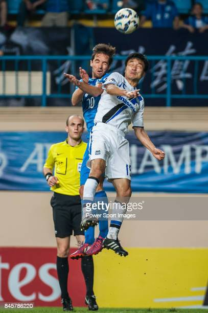 Gamba Osaka defender Konno Yasuyuki fights for the ball with Guangzhou RF midfielder Miguel Javaloyas during the 2015 AFC Champions League Group...