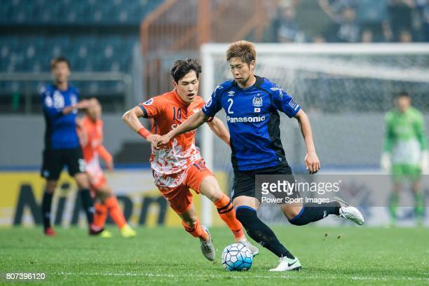Gamba Osaka Defender Miura Genta in action against Jeju United Midfielder Lee Changmin during the AFC Champions League 2017 Group H match Between...