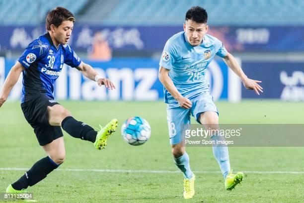 Gamba Osaka Midfielder Doan Ritsu fights for the ball with Jiangsu FC Midfielder Yang Xiaotian during the AFC Champions League 2017 Group H match...