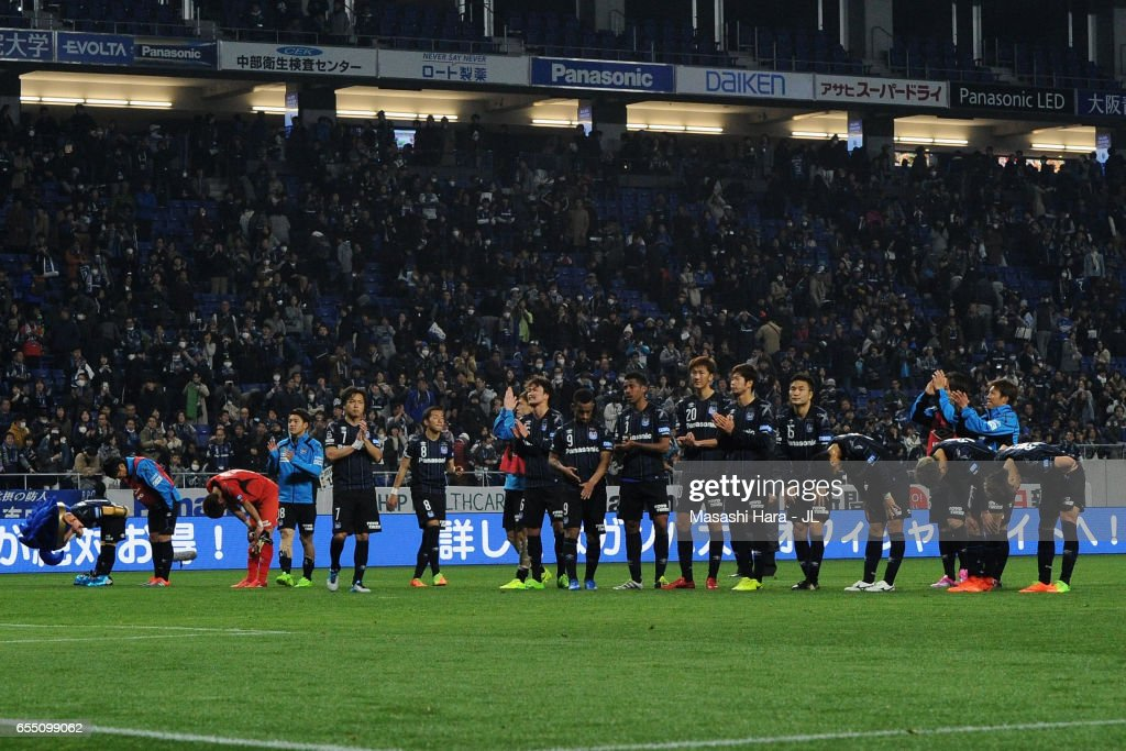 Gamba Osaka players applaud supporters after the 1-1 draw in the J.League J1 match between Gamba Osaka and Urawa Red Diamonds at Suita City Football Stadium on March 19, 2017 in Suita, Osaka, Japan.