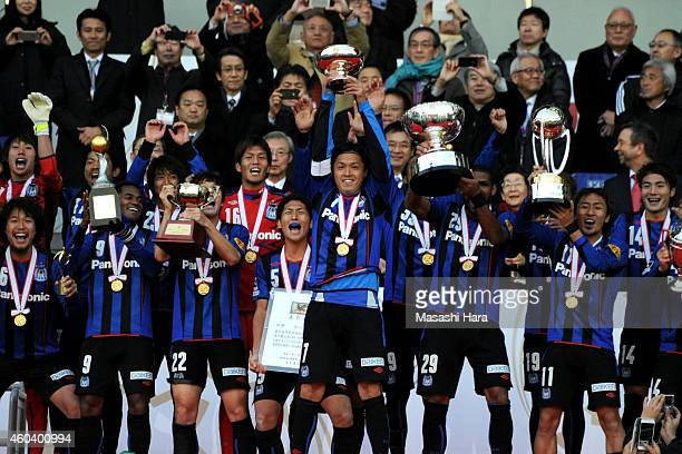 Gamba Osaka players celebrate after the Emperor's Cup final match between Gamba Osaka and Montedio Yamagata at Nissan Stadium on December 13 2014 in...