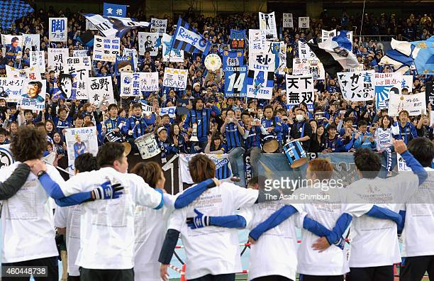 Gamba Osaka players celebrate the treble after their 31 win in the Emperor's Cup final match between Gamba Osaka and Montedio Yamagata at Nissan...