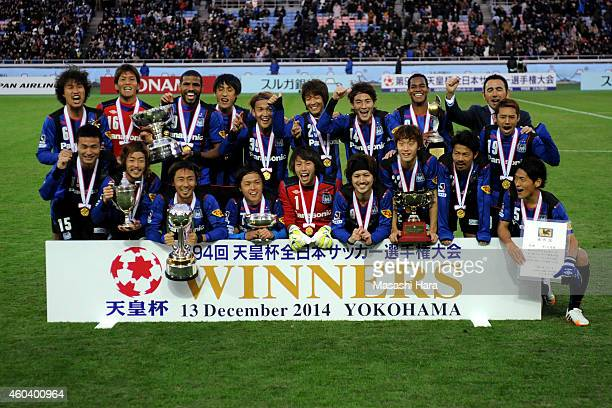 Gamba Osaka players pose for a photograph after the Emperor's Cup final match between Gamba Osaka and Montedio Yamagata at Nissan Stadium on December...