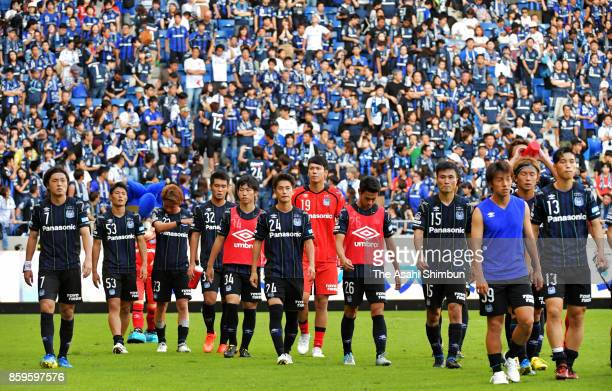 Gamba Osaka players show dejection after their 34 aggregate defeat in the JLeague Levain Cup semi final second leg match between Gamba Osaka and...