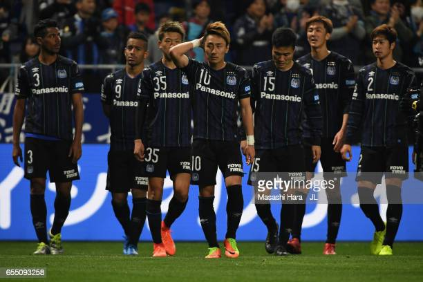 Gamba Osaka players show their frustration after the 11 draw in the JLeague J1 match between Gamba Osaka and Urawa Red Diamonds at Suita City...