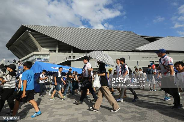 Gamba Osaka supporters arrive at the stadium prior to the JLeague J1 match between Gamba Osaka and Jubilo Iwata at Suita City Football Stadium on...