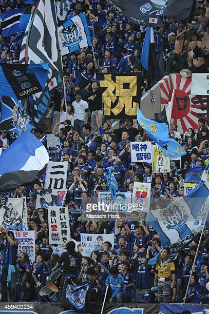 Gamba Osaka supporters celebrate the win after the JLeague match between Urawa Red Diamonds and Gamba Osaka at Saitama Stadium on November 22 2014 in...