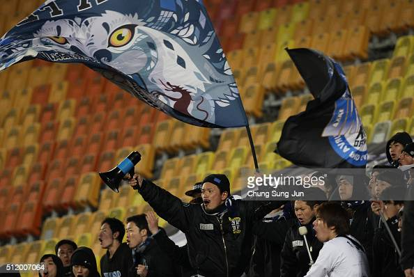 Gamba Osaka supporters cheer during the AFC Champions League Group G match between Suwon Samsung Bluewings FC and Gamba Osaka at Suwon World Cup...