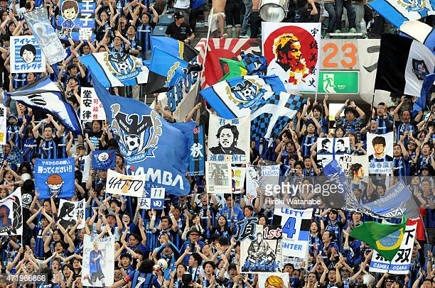 Gamba Osaka supporters cheer during the JLeague match between Urawa Red Diamonds and Gamba Osaka at Saitama Stadium on May 2 2015 in Saitama Japan