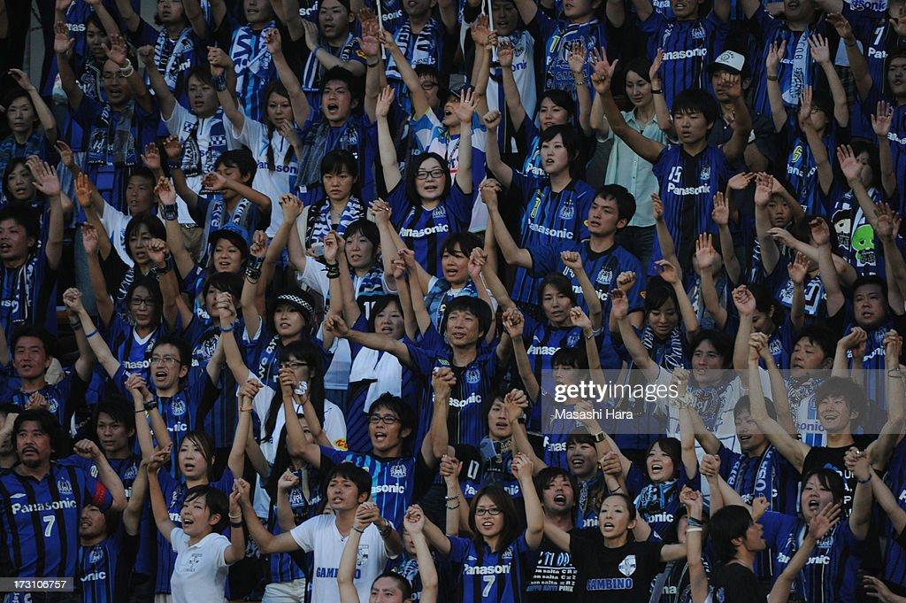 Gamba Osaka supporters cheer prior to the J.League second division match between JEF United Chiba and Gamba Osaka at Fukuda Denshi Arena on July 7, 2013 in Chiba, Japan.