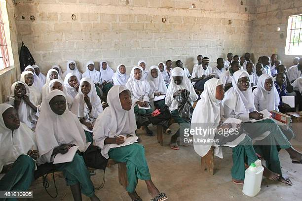 Gambia Western Gambia Tanji Tanji Village Muslim students attending a class at the Ousman Bun Afan Islamic school Girls sitting separately from boys...