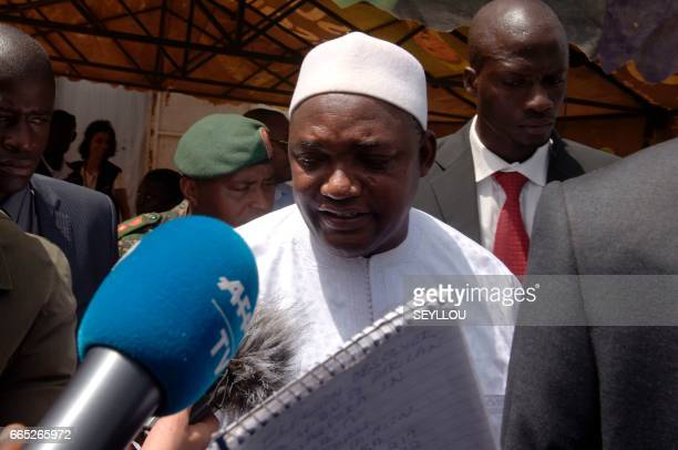 Gambian President Adama Barrow exits a polling station in Bakau on April 6 2017 during legislative elections Gambians head to the polls on April 6...