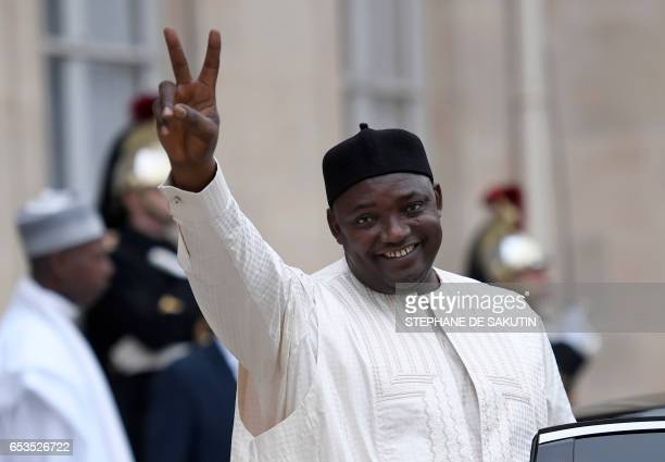 Gambian President Adama Barrow gestures as he leaves after his meeting with the French President at the Elysee Presidential Palace in Paris on March...