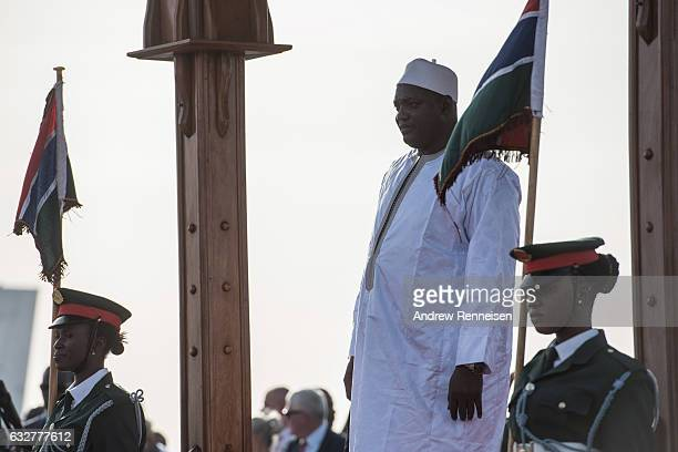 Gambian President Adama Barrow is greeted by military officials at Banjul International Airport on January 26 2017 in Banjul The Gambia Barrow had...