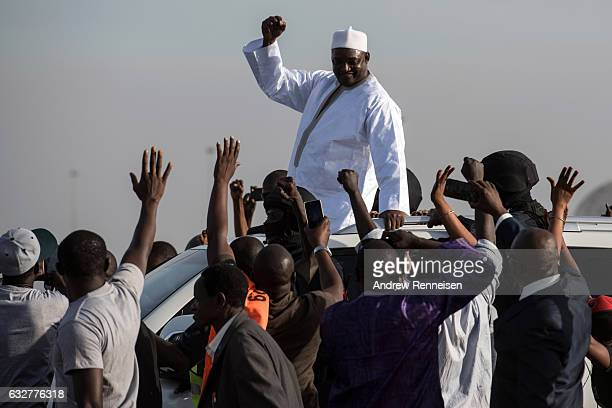 Gambian President Adama Barrow is greeted by supporters as he arrives at Banjul International Airport on January 26 2017 in Banjul The Gambia Barrow...