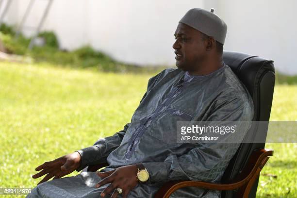 Gambian President Adama Barrow speaks during an interview in Banjul on July 26 2017 Six months ago businessman and political novice Adama Barrow took...