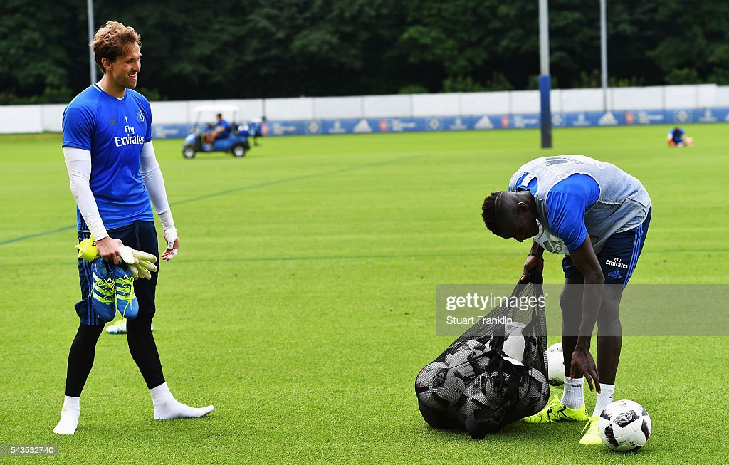 Gambian refugee Bakery Jatta collects the balls during the first training session of Hamburger SV after the summer break on June 29, 2016 in Hamburg, Germany.