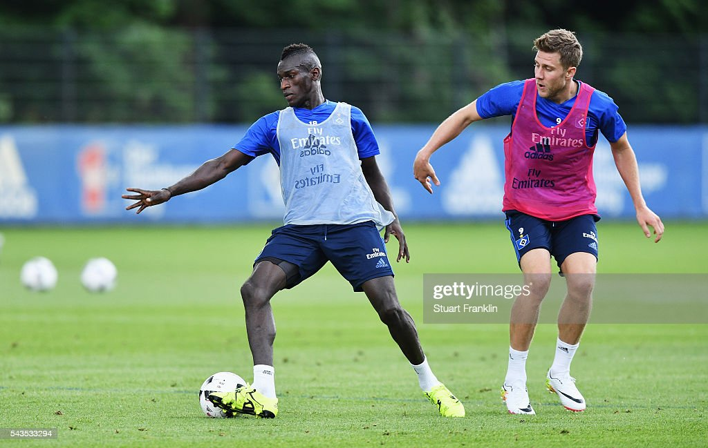 Gambian refugee Bakery Jatta is tackled by Sven Skipplock during the first training session of Hamburger SV after the summer break on June 29, 2016 in Hamburg, Germany.