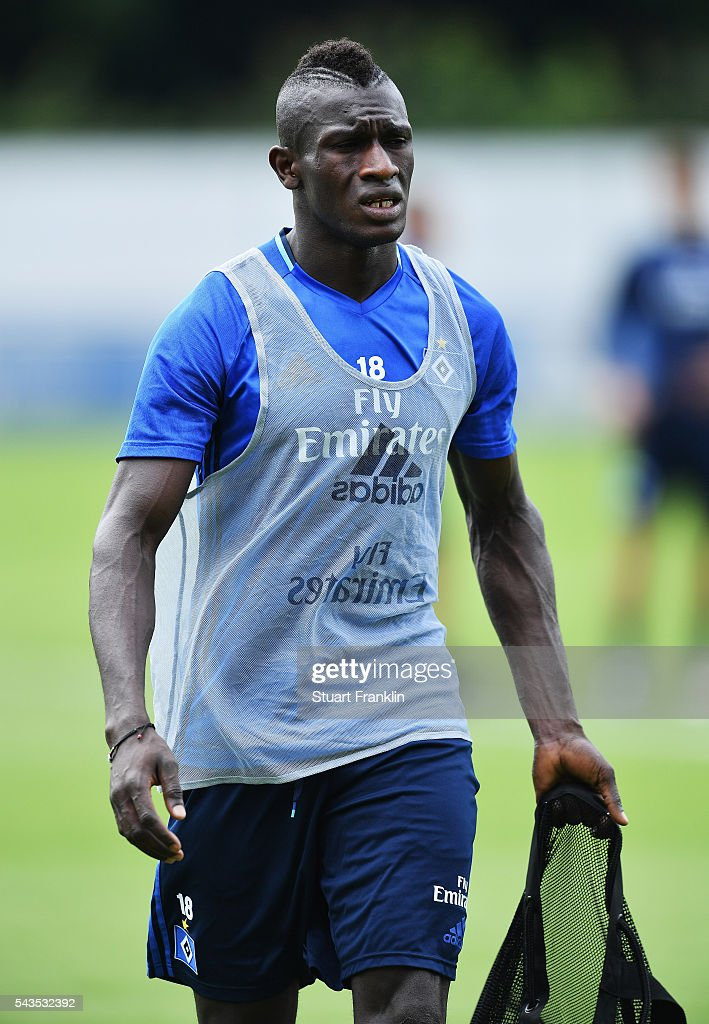 Gambian refugee Bakery Jatta looks on during the first training session of Hamburger SV after the summer break on June 29, 2016 in Hamburg, Germany.