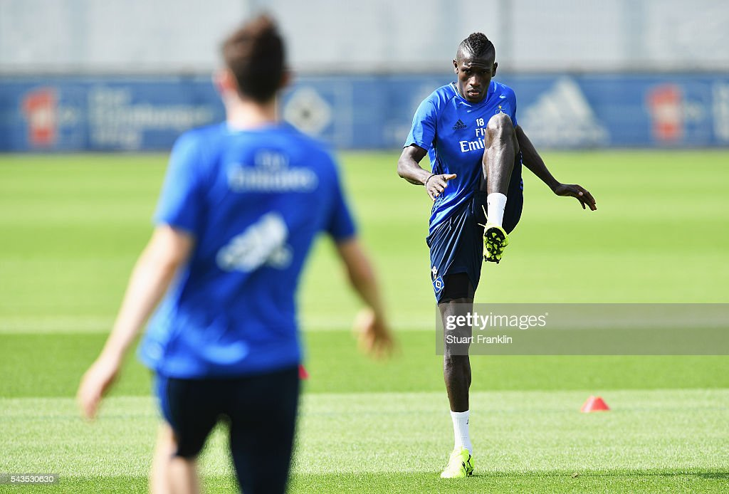 Gambian refugee Bakery Jatta stretches during the first training session of Hamburger SV after the summer break on June 29, 2016 in Hamburg, Germany.