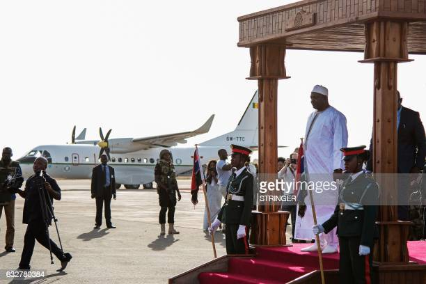 Gambia's new president Adama Barrow arrives at Banjul airport on January 26 2017 in Banjul after returning from Senegal Jubilant Gambians on Janauary...