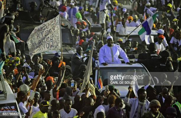 TOPSHOT Gambia's new president Adama Barrow leaves Banjul airport on January 26 2017 in Banjul after returning from Senegal Jubilant Gambians on...