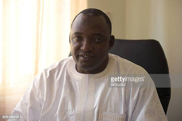 Gambia's Presidentelect Adama Barrow poses in his office in Serekunda on December 11 2016 Gambia's incumbent head of state Yahya Jammeh will contest...
