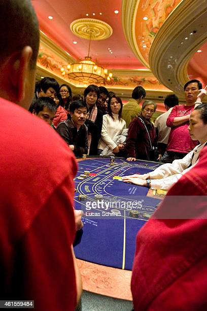Gamblers play Baccarat in Venetian casino on December 17 2009 in Macao China
