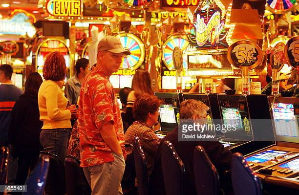 Gamblers play the slot machines in a casino on Fremont Street on November 21 2002 in Las Vegas Nevada