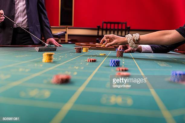 Gamblers playing roulette in a casinoi