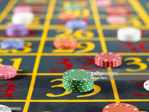 Gambling chips on roulette table, close-up