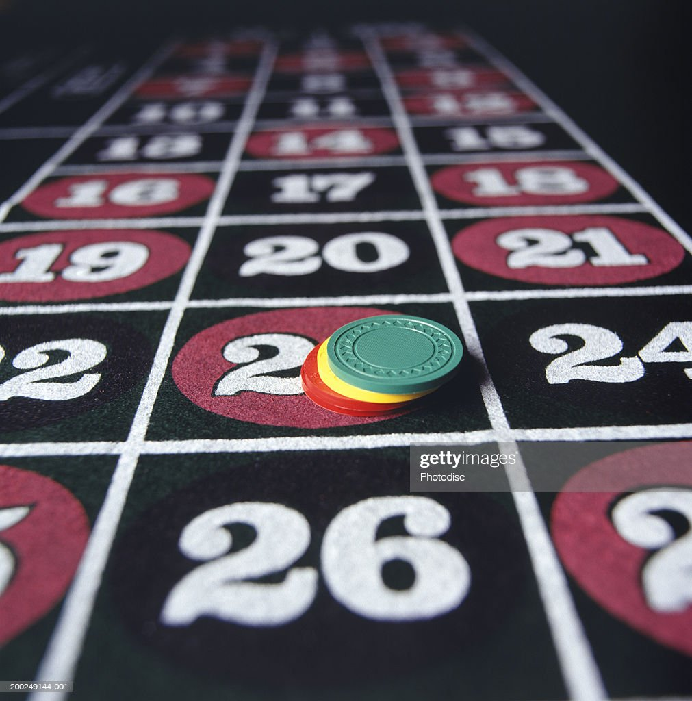 Gambling chips on roulette table, (Close-up) : Stock Photo